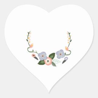 Guirnalda floral pegatina en forma de corazón
