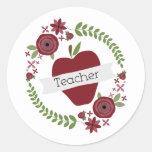 Guirnalda floral y profesor rojo de Apple Etiqueta Redonda