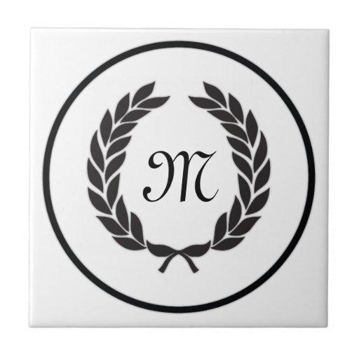 Guirnalda negra del laurel del monograma azulejos