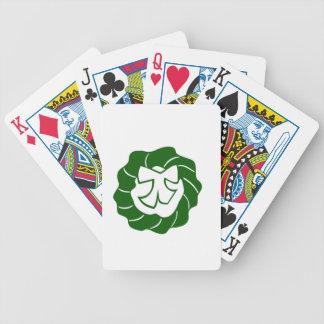 Guirnalda verde del navidad con el arco baraja cartas de poker