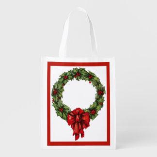 Guirnalda y bayas del acebo del navidad del bolsas reutilizables