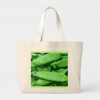 Guisantes frescos de la primavera bolsas
