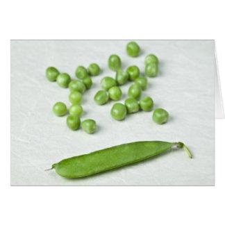 Guisantes verdes y cáscara felicitacion