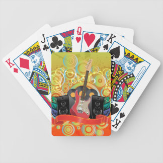 guitar and speakers with funky background bicycle playing cards