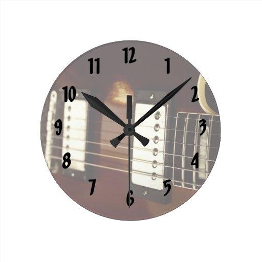 guitar brown electric strings and bridge close up. wallclocks