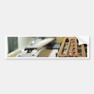 Guitar grips repairing shallow dof bumper stickers