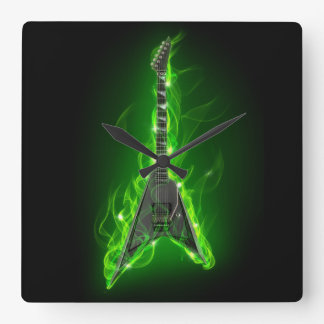 Guitar in Green Flames Wall Clock