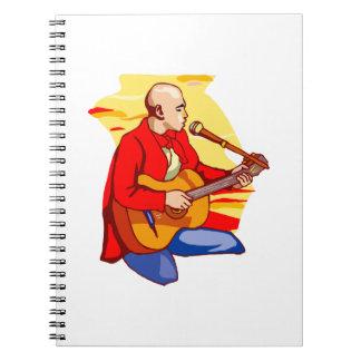 guitar kneeling bald singing red.png notebook