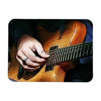 Guitar player magnet