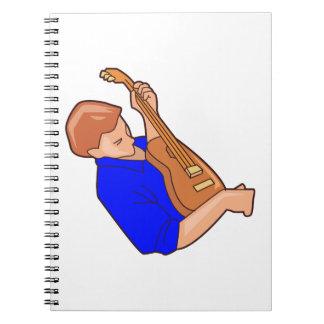 guitar player man sideways blue.png notebook