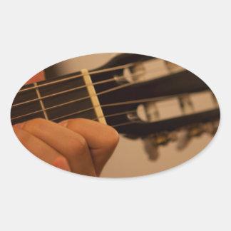 guitar player oval sticker