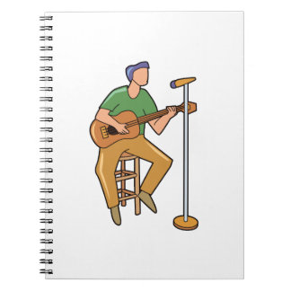 guitar player sitting abstract mic.png notebook