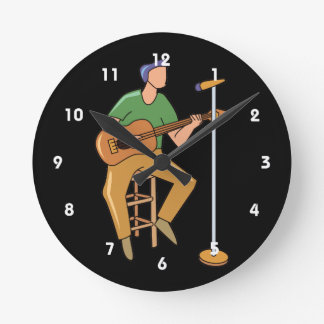 guitar player sitting abstract mic.png round clock