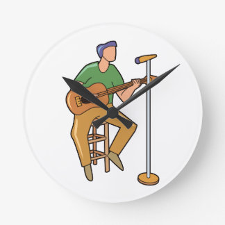 guitar player sitting abstract mic.png round wallclock