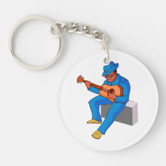 guitar player sitting on amp blues blue.png keychain