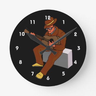 guitar player sitting on amp blues brown.png round clocks