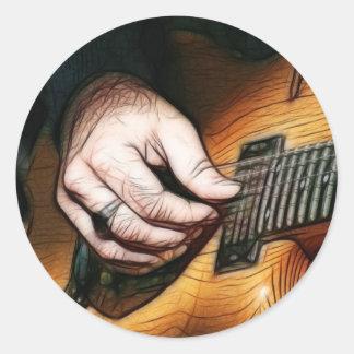 Guitar player classic round sticker
