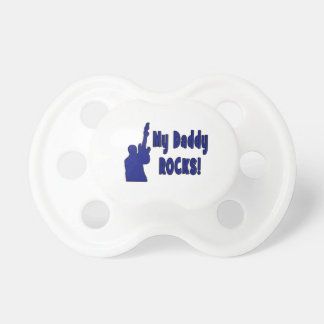 guitar rocks blue holding up electric daddy rocks. pacifier
