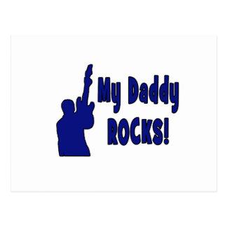 guitar rocks blue holding up electric daddy rocks. postcard