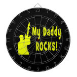 guitar rocks yellow holding up electric daddy rock dartboard with darts