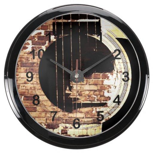 Guitar strings and brick wall aqua clocks