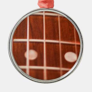 Guitar strings metal ornament