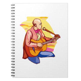 guitarist kneeling bald singing.png spiral notebook