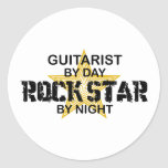 Guitarist Rock Star by Night Classic Round Sticker