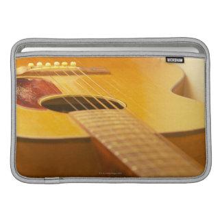 Guitarra acústica 5 fundas MacBook