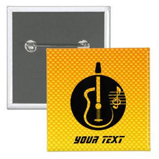 Guitarra acústica amarillo-naranja pins