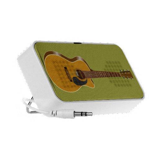 Guitarra acústica cortada laptop altavoz