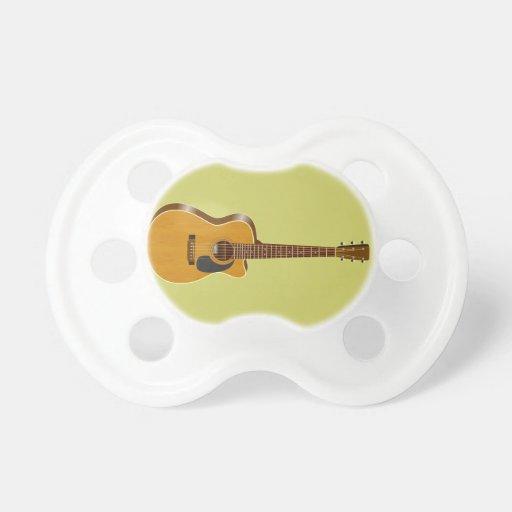 Guitarra acústica cortada chupetes de bebé
