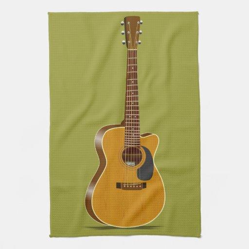 Guitarra acústica cortada toallas