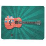Guitarra acústica envejecida y llevada de la bande cuadernos