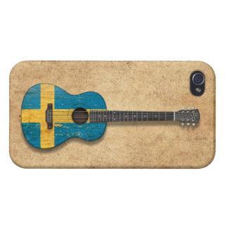 Guitarra acústica envejecida y llevada de la bande iPhone 4 protector