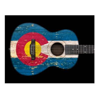 Guitarra acústica envejecida y llevada de la bande postales