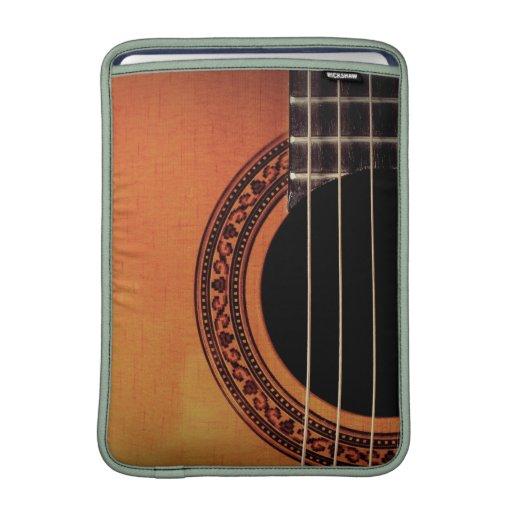 Guitarra acústica funda macbook air