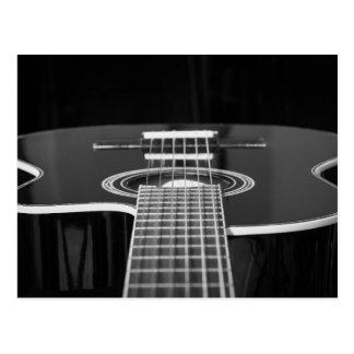Guitarra acústica negra y blanca elegante postales