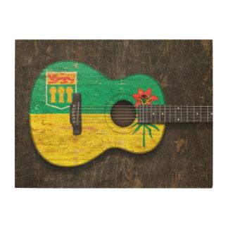 Guitarra acústica rasguñada de la bandera de impresiones en madera