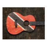 Guitarra acústica rasguñada de la bandera de postal