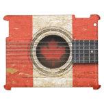 Guitarra acústica vieja con la bandera canadiense