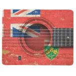 Guitarra acústica vieja con la bandera de Ontario