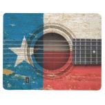 Guitarra acústica vieja con la bandera de Tejas