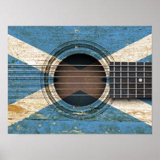 Guitarra acústica vieja con la bandera escocesa poster