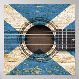 Guitarra acústica vieja con la bandera escocesa impresiones