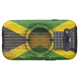 Guitarra acústica vieja con la bandera jamaicana galaxy SIII carcasa