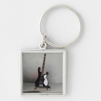 Guitarra blanco y negro llavero cuadrado plateado
