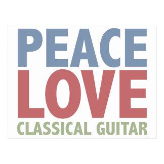 Guitarra clásica del amor de la paz postal
