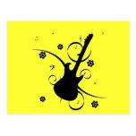 Guitarra con las notas musicales postal