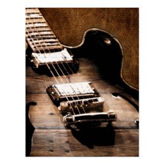 Guitarra de la música country en el fondo de cuero postal